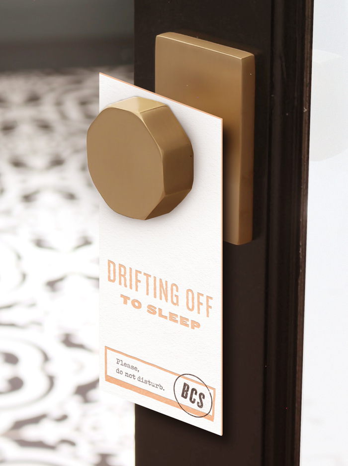 Drifting off to sleep door hanger