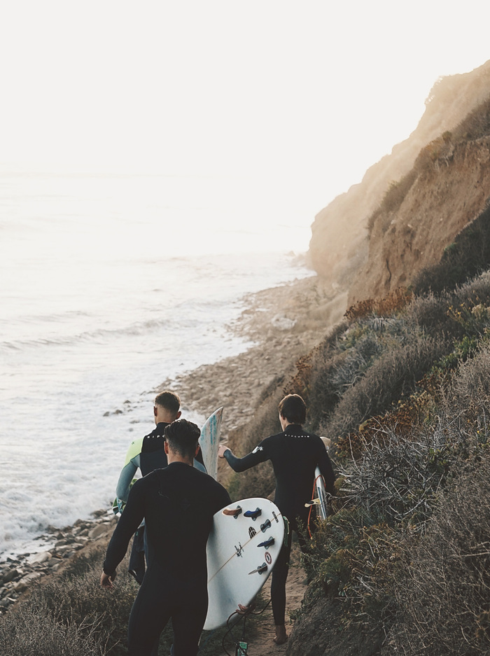 Surfers hiking in to a cool surf spot