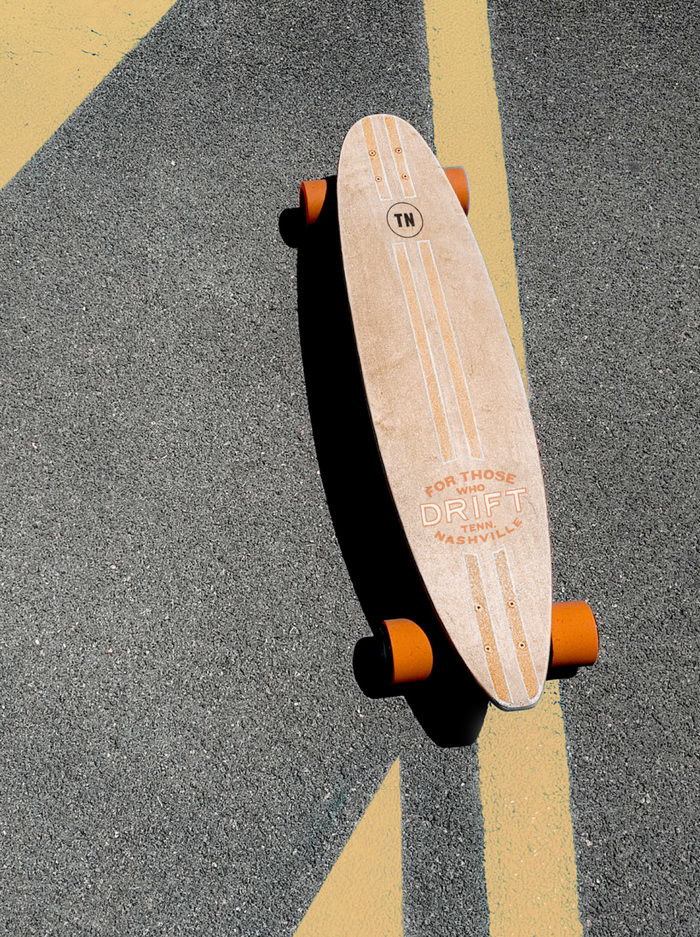 Drift branded longboard skateboard on asphalt