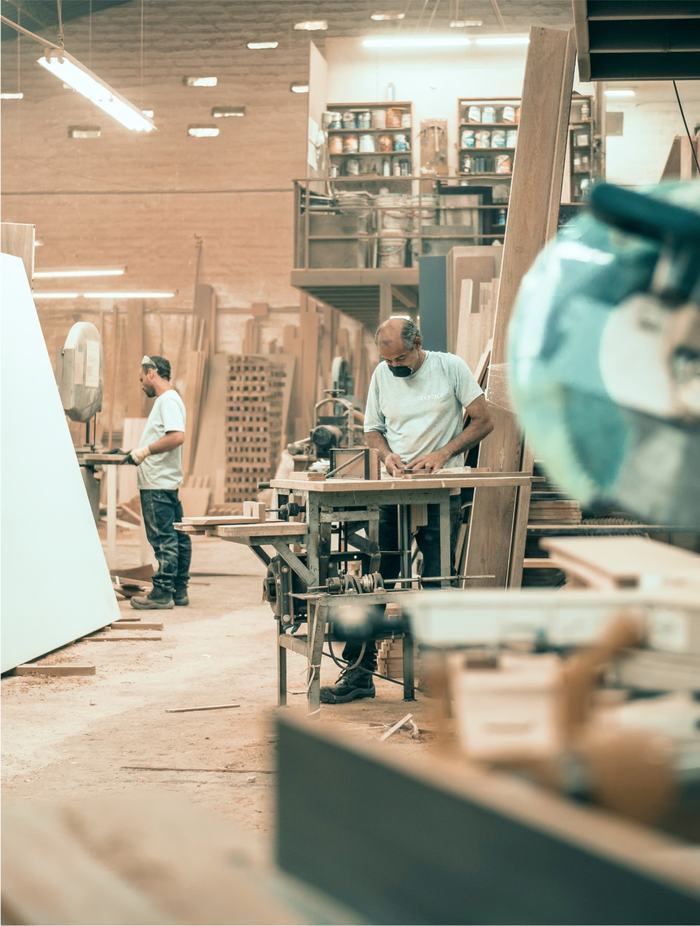 People working in a wood shop