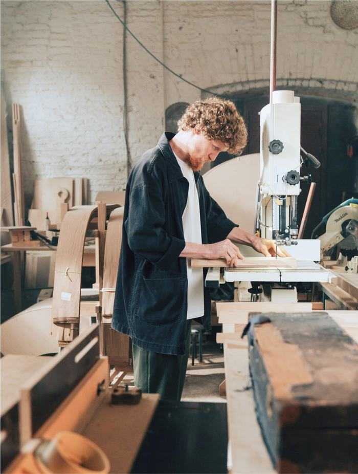 Person using a saw in a workshop
