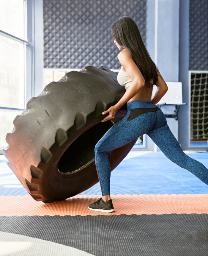 Person lifting large tire