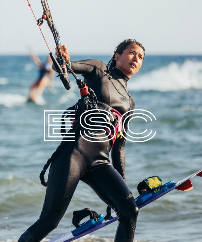 ESC logo overlaid on person getting ready to windsurf
