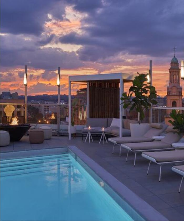 Hedy's Rooftop pool, seating, and sunset