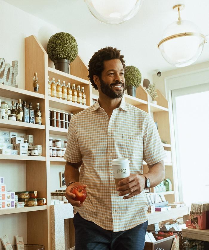 Man grabbing a coffee at ENO