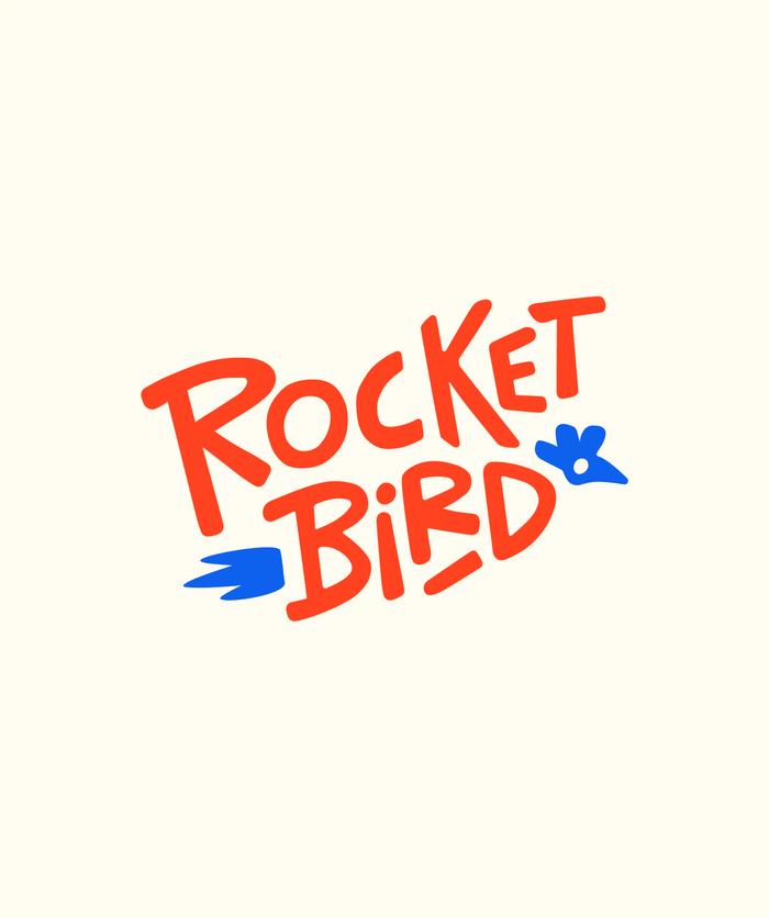 Primary rocketbird logo, orange type with blue glyphs on cream background