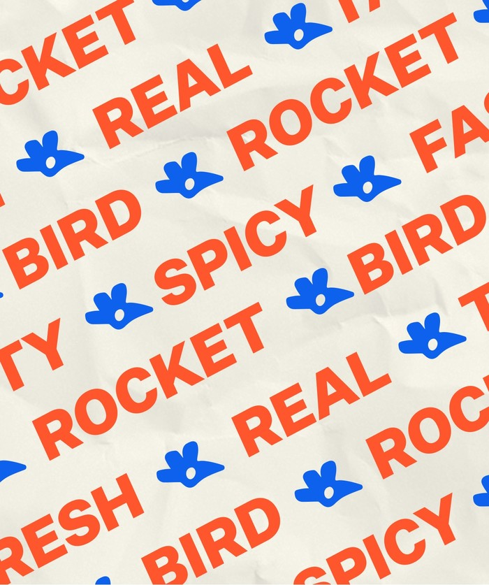 tissue paper with bold repeated type saying 'ROCKET-BIRD-FRESH-REAL-TASTY-FAST-SPICY'
